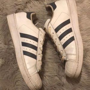Grey striped Adidas Superstars